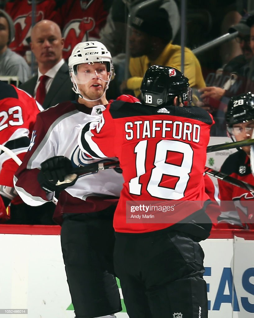 check out fbdcc 2a891 Drew Stafford of the New Jersey Devils Carl Soderberg of the ...