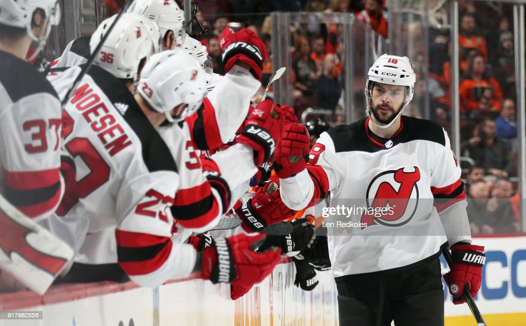 Drew Stafford #18 of the New Jersey Devils celebrates with his teamamtes on the bench after scoring the game-winning goal in a shootout to defeat the Philadelphia Flyers 5-4 on February 13, 2018 at the Wells Fargo Center in Philadelphia, Pennsylvania.