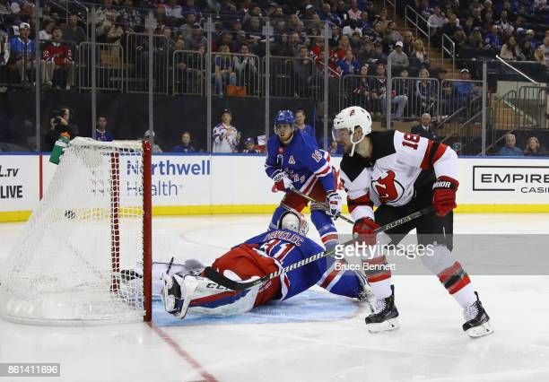 Drew Stafford of the New Jersey Devils scores the game winning goal on the powerplay at 100 of the third period against Ondrej Pavelec of the New...