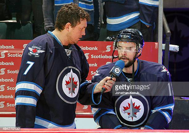 Drew Stafford of the Winnipeg Jets answers questions from Jets Game Night Host Brody Jackson following a 5-4 victory over the Minnesota Wild at the...