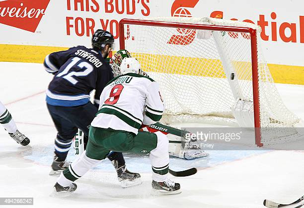 Drew Stafford of the Winnipeg Jets chips the puck into the net for a second period goal against the Minnesota Wild at the MTS Centre on October 25...
