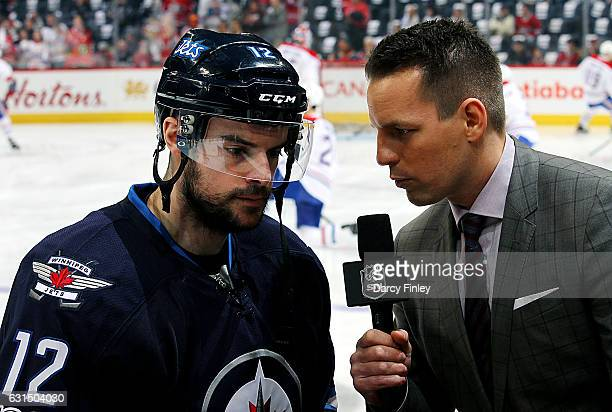 Drew Stafford of the Winnipeg Jets does a pregame interview with Sportsnet reporter Sean Reynolds prior to NHL action against the Montreal Canadiens...