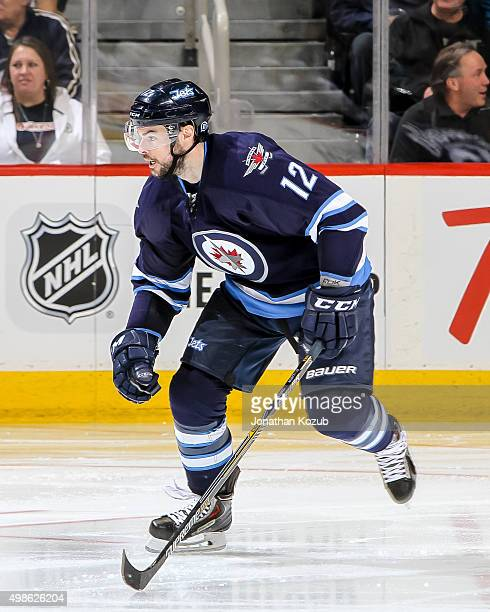 Drew Stafford of the Winnipeg Jets follows the play down the ice during third period action against the Vancouver Canucks at the MTS Centre on...