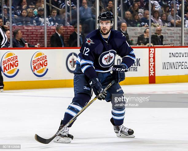 Drew Stafford of the Winnipeg Jets keeps an eye on the play during second period action against the Arizona Coyotes at the MTS Centre on January 26...
