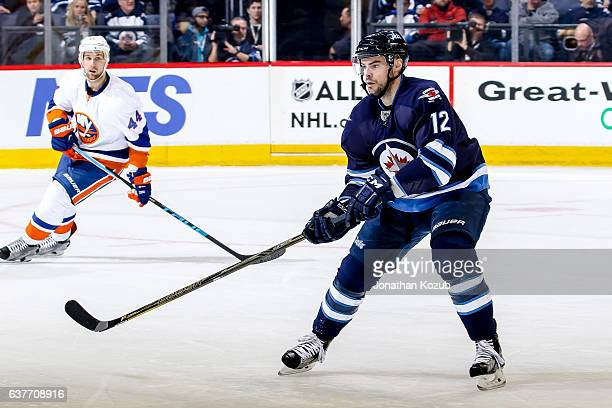 Drew Stafford of the Winnipeg Jets keeps an eye on the play during second period action against the New York Islanders at the MTS Centre on December...