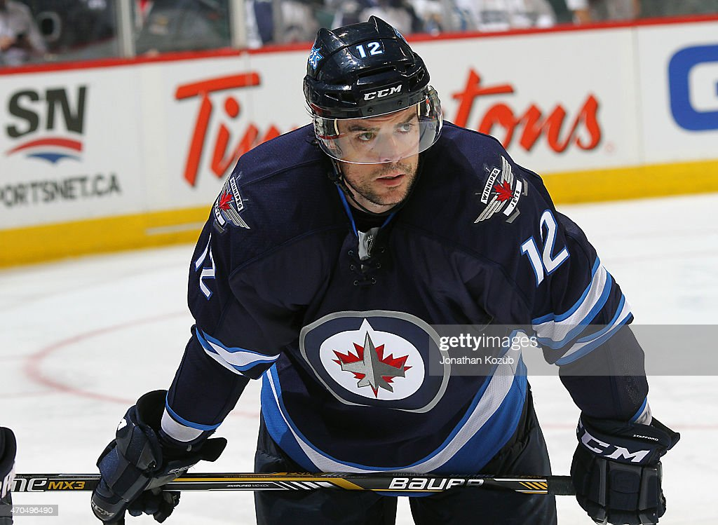Drew Stafford #12 of the Winnipeg Jets looks on dejectedly after the Jets fell 5-4 in overtime to the Anaheim Ducks in Game Three of the Western Conference Quarterfinals during the 2015 NHL Stanley Cup Playoffs on April 20, 2015 at the MTS Centre in Winnipeg, Manitoba, Canada. The Ducks lead the series 3-0.