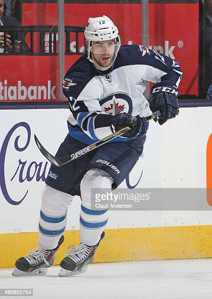 Drew Stafford of the Winnipeg Jets skates against the Toronto Maple Leafs during an NHL game at the Air Canada Centre on November 4 2015 in Toronto...