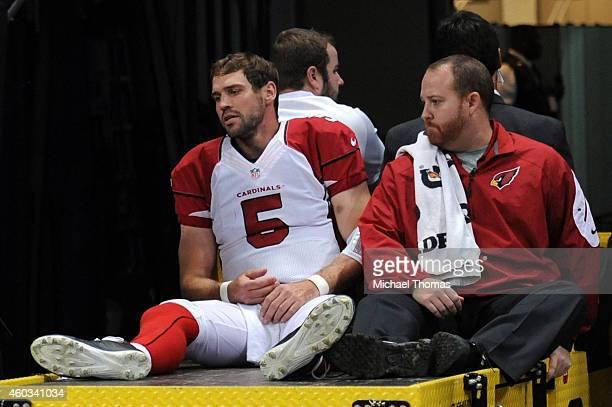 Drew Stanton of the Arizona Cardinals gets carted off the field after getting injured on a sack by Aaron Donald of the St Louis Rams in the third...