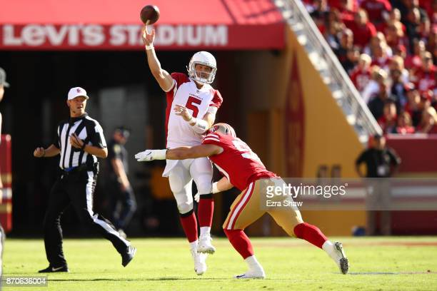 Drew Stanton of the Arizona Cardinals is hit by Brock Coyle of the San Francisco 49ers during their NFL game at Levi's Stadium on November 5, 2017 in...