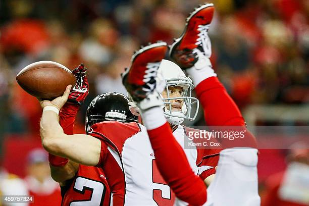 Drew Stanton of the Arizona Cardinals throws a pass during the first half against the Atlanta Falcons at the Georgia Dome on November 30 2014 in...