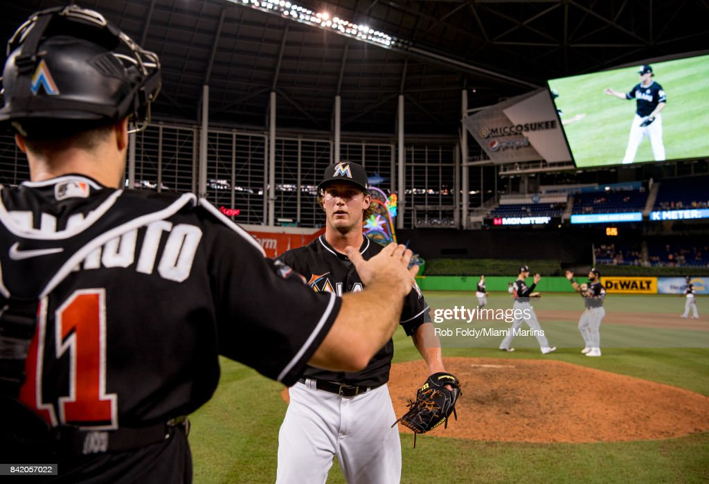 Drew Steckenrider #71 hugs J.T. Realmuto #11 of the Miami Marlins after the game against the Philadelphia Phillies at Marlins Park on September 2, 2017 in Miami, Florida.
