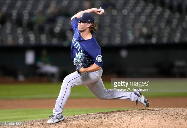 Drew Steckenrider of the Seattle Mariners pitches against the Oakland Athletics in the bottom of the ninth inning at RingCentral Coliseum on...