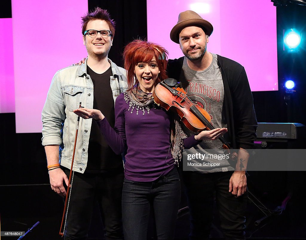 Drew Steen, Lindsey Stirling and Jason Gaviati visit 'You & A' at Music Choice on May 1, 2014 in New York City.