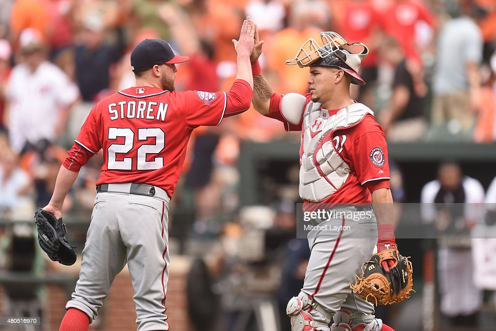 Drew Storen #22 and Wilson Ramos #40 of the Washington Nationals celebrate a win after a baseball game against the Baltimore Orioles at Oriole Park at Camden Yards on July 12, 2015 in Baltimore, Maryland. The Nationals won 3-2.
