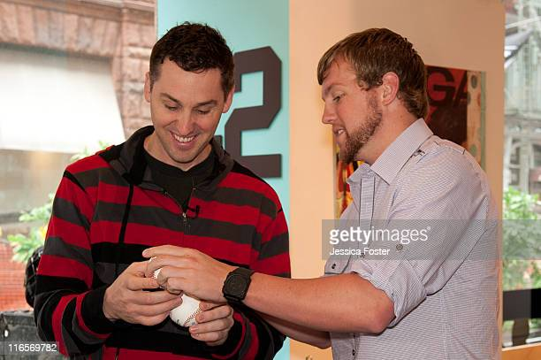 Drew Storen relief pitcher for the Washington Nationals autographs a baseball for Mike O'Hara at the MLB Fan Cave located on Broadway and 4th Street...