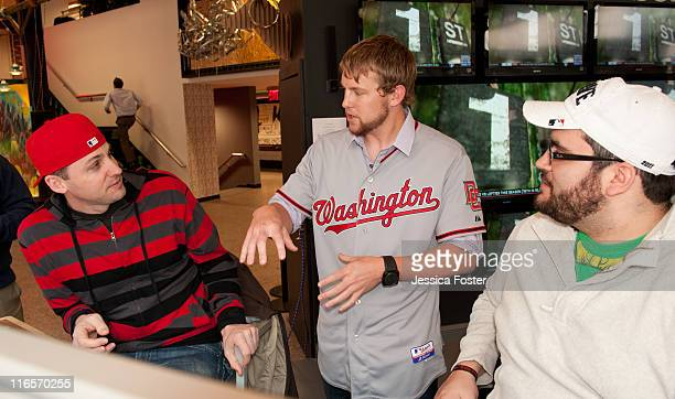 Drew Storen relief pitcher for the Washington Nationals is seen talking to Mike O'Hara and Ryan Wagner at the MLB Fan Cave located on Broadway and...