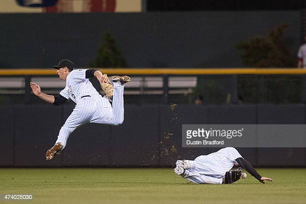 Drew Stubbs and DJ LeMahieu of the Colorado Rockies collide as a fly ball falls into center field in the 8th inning of a game against the...
