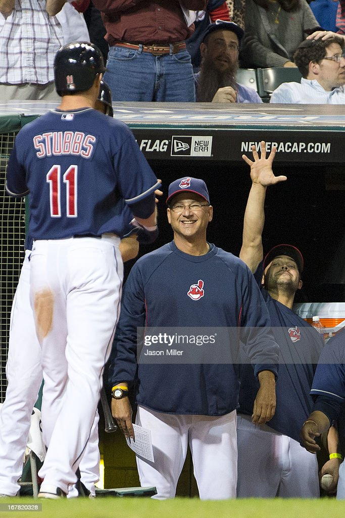Drew Stubbs #11 celebrates with Manager Terry Francona #17 and Nick Swisher #33 of the Cleveland Indians after Stubbs hit a solo home run during the seventh inning at Progressive Field on April 30, 2013 in Cleveland, Ohio.