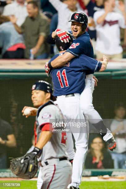Drew Stubbs celebrates with Ryan Raburn of the Cleveland Indians after Stubbs scored to win the game in the ninth inning against the Washington...