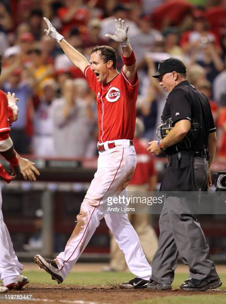 Drew Stubbs of the Cincinnati Reds celebrates after hitting a home run to win the game in the 9th inning during the game against the Atlanta Braves...