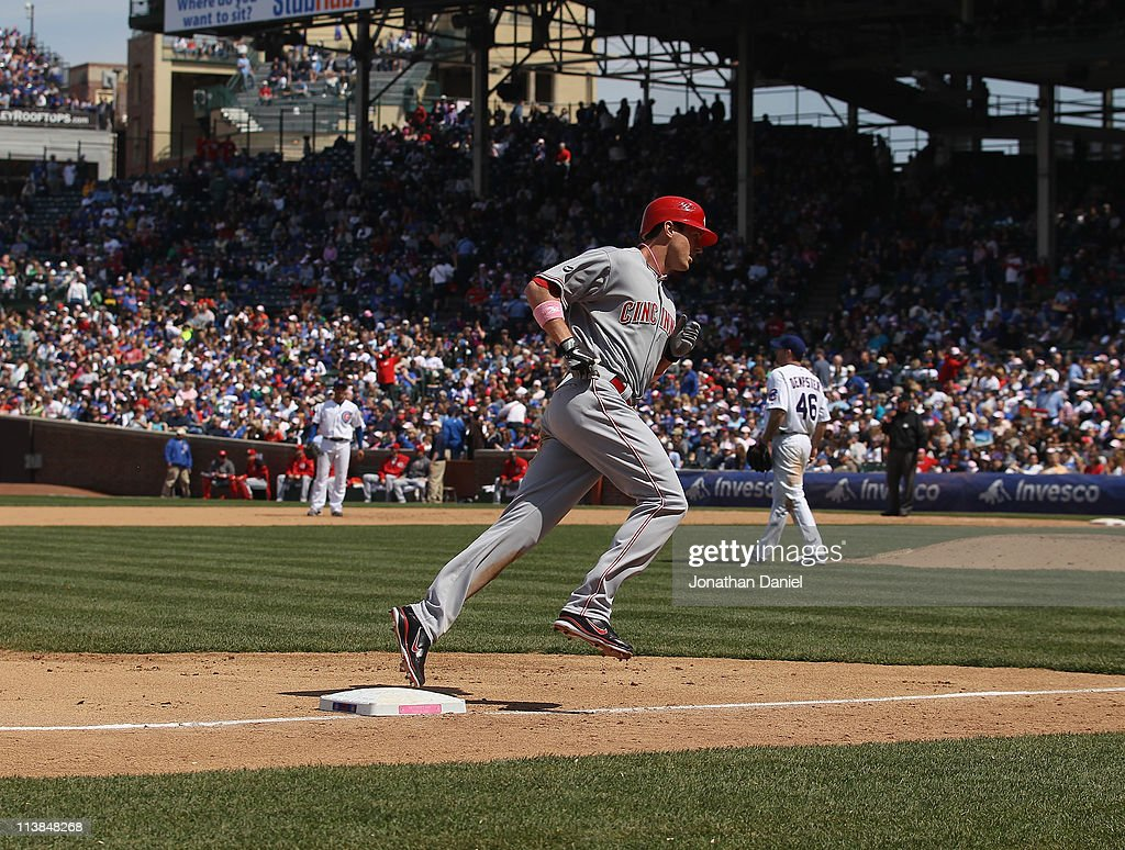 Drew Stubbs #6 of the Cincinnati Reds rounds third base after hitting a solo home run in the 5th inning against Ryan Dempster #46 of the Chicago Cubs at Wrigley Field on May 8, 2011 in Chicago, Illinois.