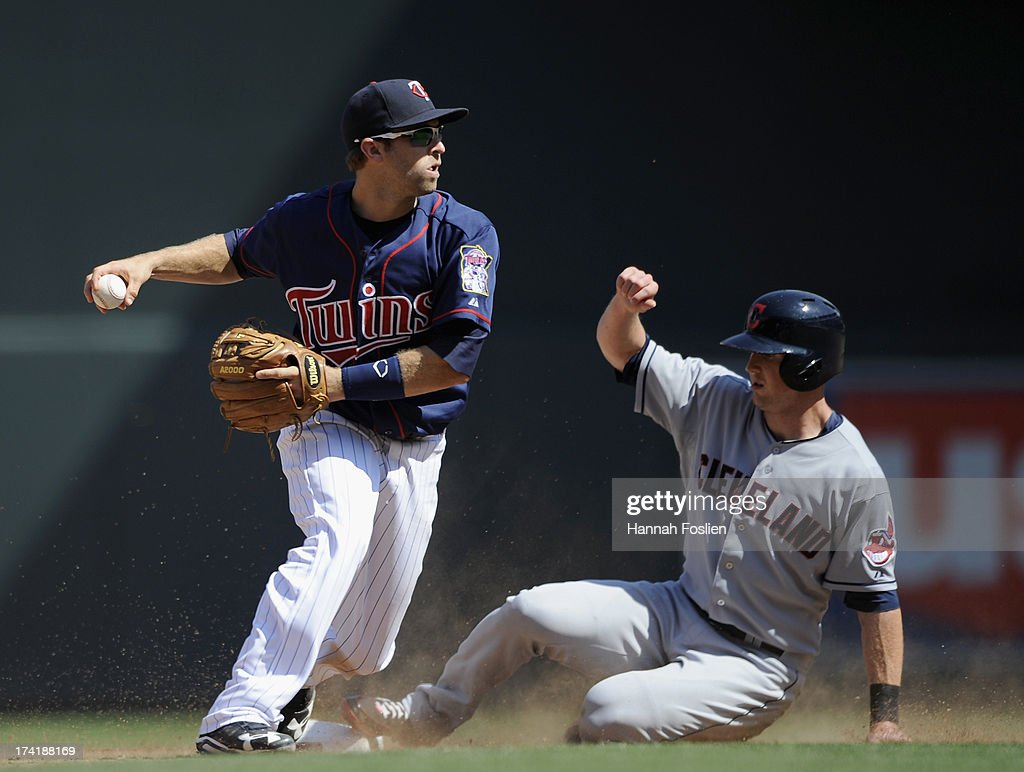 Drew Stubbs #11 of the Cleveland Indians is out at second base as Brian Dozier #2 of the Minnesota Twins looks to turn a double play during the ninth inning of the game on July 21, 2013 at Target Field in Minneapolis, Minnesota. The Indians defeated the Twins 7-1.