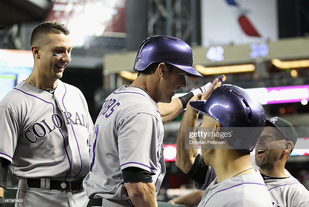 Drew Stubbs #13 of the Colorado Rockies high-fives manager Walt Weiss #22 after Stubbs hit a solo home run against the Arizona Diamondbacks during the ninth inning of the MLB game at Chase Field on April 29, 2014 in Phoenix, Arizona. The Rockies defeated the Diamondbacks 5-4.