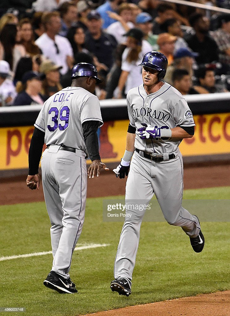 Drew Stubbs #13 of the Colorado Rockies, right, is congratulated by Stu Cole #39 after he hit a solo home run during the eighth inning of a baseball game against the San Diego Padres at Petco Park September, 23, 2014 in San Diego, California.