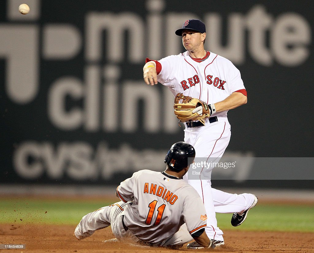 Drew Sutton #44 of the Boston Red Sox gets Robert Andino #11 of the Baltimore Orioles out at second but is unable to turn the double play in the ninth inning on July 7, 2011 at Fenway Park in Boston, Massachusetts. The Boston Red Sox defeated the Baltimore Orioles 10-4.
