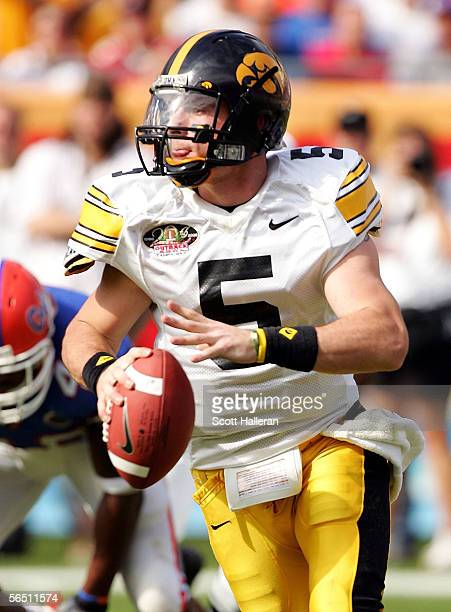 Drew Tate of the Iowa Hawkeyes looks upfield to pass against the Florida Gators during the Outback Bowl on January 2 2006 at Raymond James Stadium in...