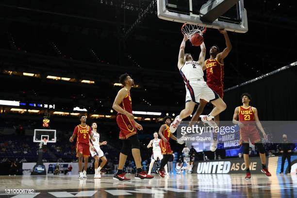 Drew Timme of the Gonzaga Bulldogs dunks the ball against Evan Mobley of the USC Trojans during the first half in the Elite Eight round game of the...