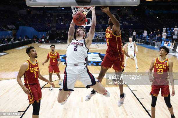 Drew Timme of the Gonzaga Bulldogs dunks the ball during the first half against the USC Trojans in the Elite Eight round game of the 2021 NCAA Men's...