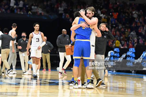 Drew Timme of the Gonzaga Bulldogs embraces Jaime Jaquez Jr. #4 of the UCLA Bruins after the Bulldogs' overtime win in the Final Four semifinal game...