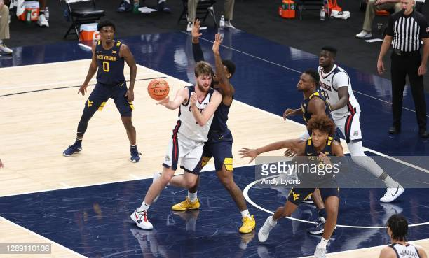 Drew Timme of the Gonzaga Bulldogs passes the ball against the West Virginia Mountaineers during the Jimmy V Classic at Bankers Life Fieldhouse on...