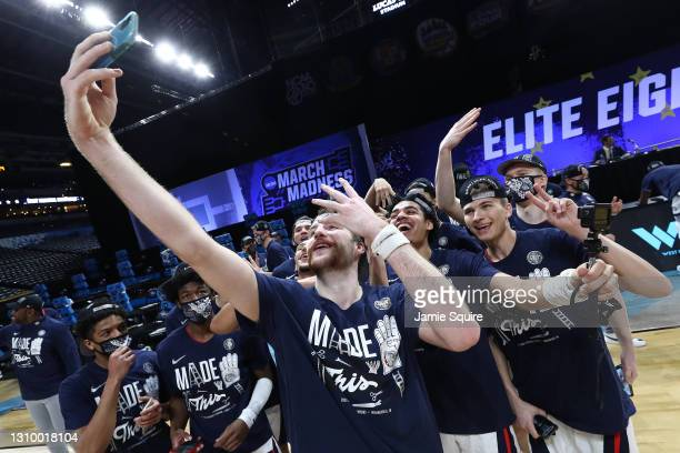 Drew Timme of the Gonzaga Bulldogs poses with teammates after defeating the USC Trojans 85-66 in the Elite Eight round game of the 2021 NCAA Men's...
