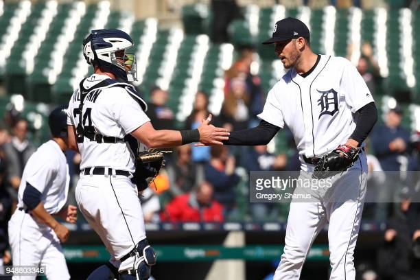 Drew VerHagen of the Detroit Tigers celebrates with James McCann after beating the Baltimore Orioles 138 at Comerica Park on April 19 2018 in Detroit...
