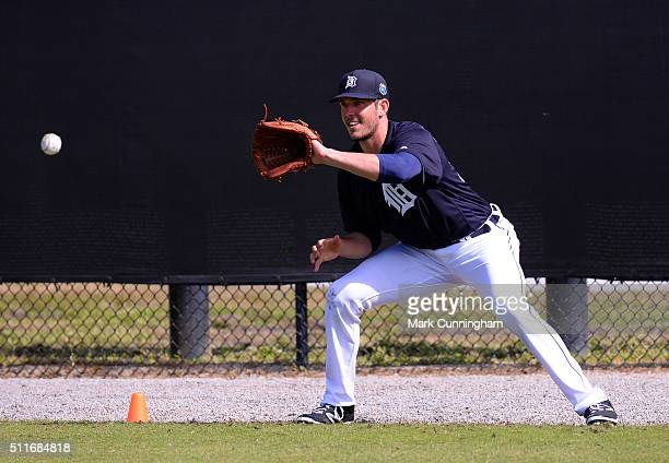 Drew VerHagen of the Detroit Tigers fields during the rag ball drill during the Spring Training workout day at the TigerTown Facility on February 20...