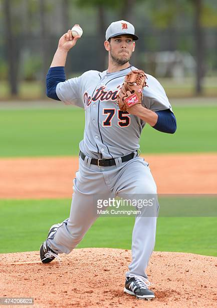 Drew VerHagen of the Detroit Tigers pitches during the spring training workout day at the TigerTown complex on February 22 2014 in Lakeland Florida