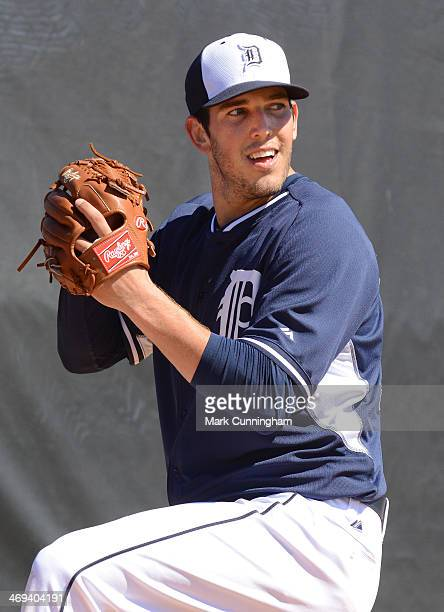 Drew VerHagen of the Detroit Tigers throws a pitch during the Tigers workout day at the TigerTown Complex on February 14 2014 in Lakeland Florida