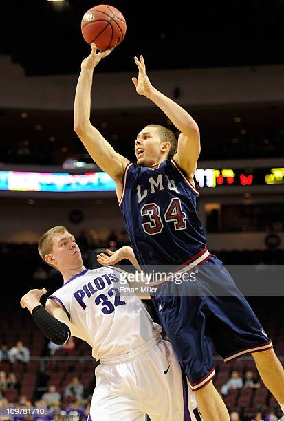Drew Viney of the Loyola Marymount Lions shoots over Ryan Nicholas of the Portland Pilots during the first round of the Zapposcom West Coast...