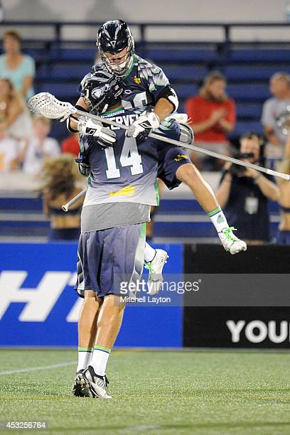 Drew Westervelt of the Chesapeake Bayhawks celebrates a goal with Jesse Bernhardt during a Major League Lacrosse game against the Denver Outlaws on...