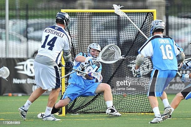 Drew Westervelt of the Chesapeake Bayhawks scores on goalie Brian Phipps of the Ohio Machine in the first period on July 6 2013 at Selby Stadium in...
