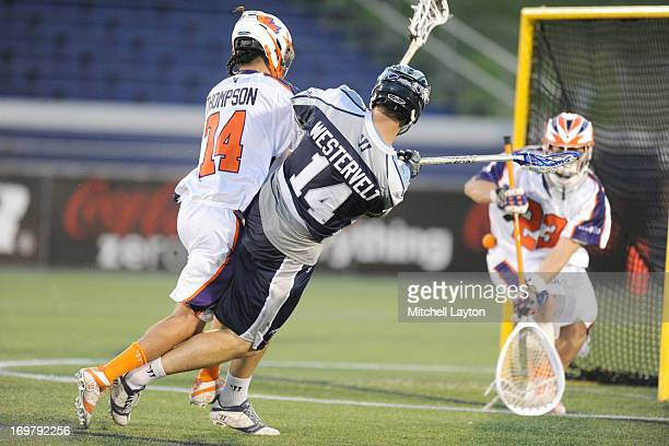 Drew Westervelt of the Chesapeake Bayhawks takes a shot with pressure from Jeremy Thompson#74 of the Hamilton Nationals during a MLL game on June 1...