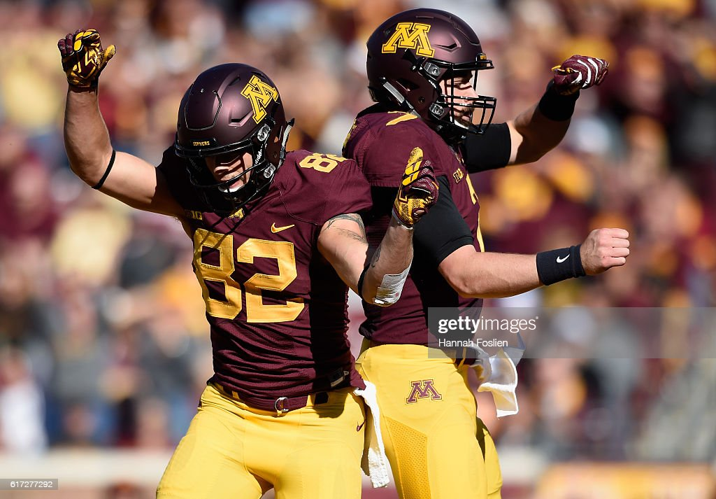 Drew Wolitarsky #82 of the Minnesota Golden Gophers congratulates teammate Mitch Leidner #7 on a touchdown against the Rutgers Scarlet Knights during the first quarter of the game on October 22, 2016 at TCF Bank Stadium in Minneapolis, Minnesota.