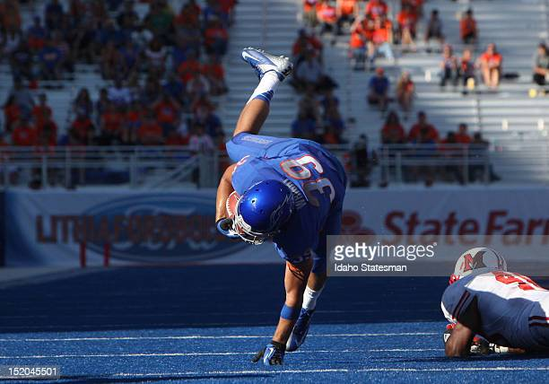 Drew Wright of Boise State is tripped up by Chris Wade of Miami at Bronco Stadium in Boise, Idaho, on Saturday September 15, 2012. Boise State...