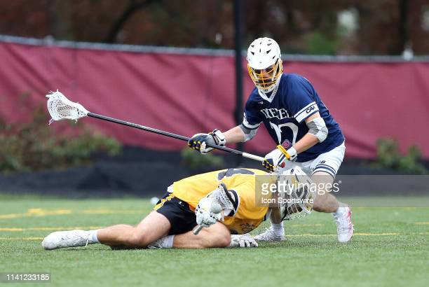 Drexel Dragons Charlie Maly and Towson Tigers Brendan Sunday in action during the CAA Championship game between Drexel Dragons and Towson Tigers on...
