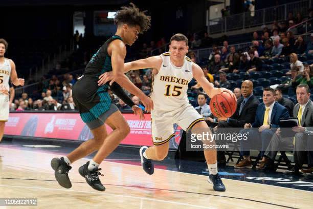 Drexel Dragons Guard Matey Juric dribbles the ball with UNCW Seahawks Guard Shykeim Phillips defending during the second half of the Colonial...