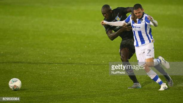 Drey Wright of Colchester United tussle with Aston Villa's Christopher Samba during Carabao Cup First Round match between Colchester United and Aston...