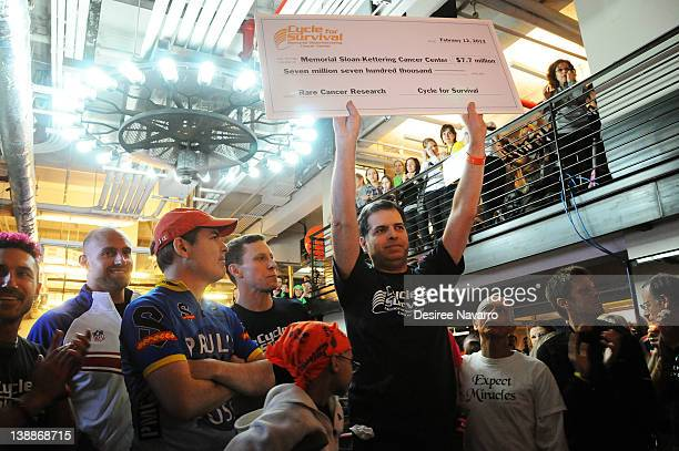 DrGary Schwartz holds up a check at the 2012 Cycle For Survival Day 2 at Equinox Graybar on February 12 2012 in New York City