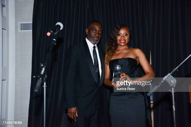 DrHenry Paul and Midwin Charles attend the NOAH NY 10th Anniversary Gala at Brooklyn Botanic Gardens on May 22 2019 in New York City